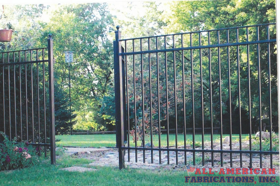 wrought iron garden gate and fence